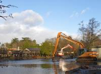 Cleaning out the water with hippos on site