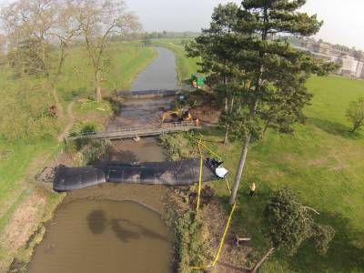 We are using innovative Aqua Dams and long reach with rubber tracks to minimise impact on the environment during the installation of the new bridge